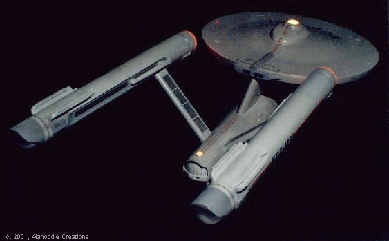 Enterprise, top, behind